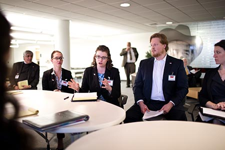 Students from various delegations negotiate in a common space