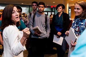 Professor Sherri Greenberg talks with MPAff students during orientation
