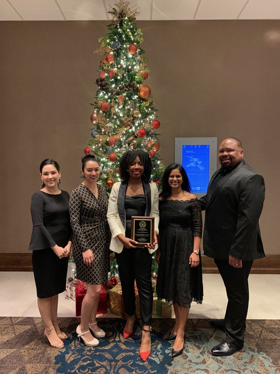 Virginia A. Cumberbatch (MPAff '16) and the rest of the team at the UT Austin DDCE Center for Community Engagement accepts an award from the NAACP