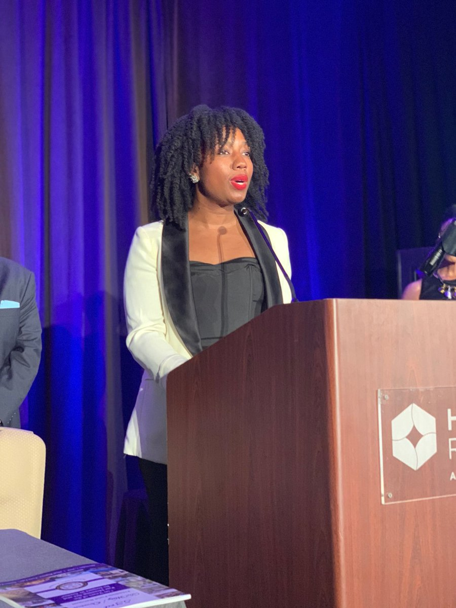 Virginia A. Cumberbatch (MPAff '16) of the UT Austin DDCE Center for Community Engagement accepts an award from the NAACP