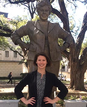 Erin Smith, student co-chair of the Barbara Jordan National Forum, stands in front of the Barbara Jordan statue