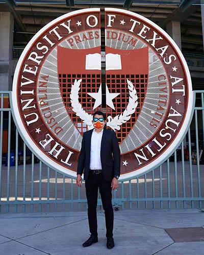 Gabriel Cortez (MGPS '21) in front of the UT shield at Darrell K Royal-Texas Memorial Stadium