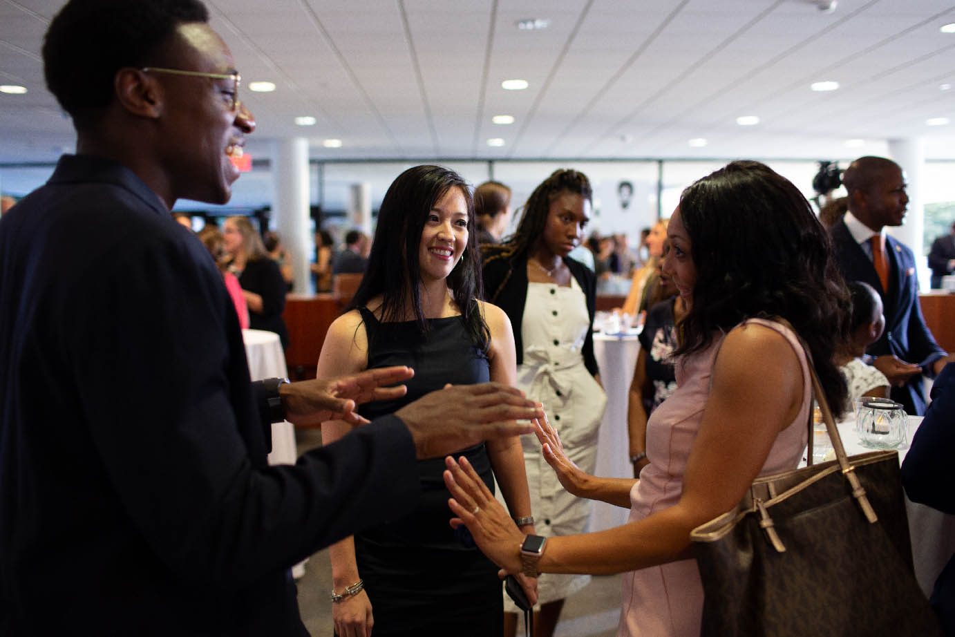 LBJ students chat during the 2019 Outstanding Alumni Awards reception on Sept. 20, 2019