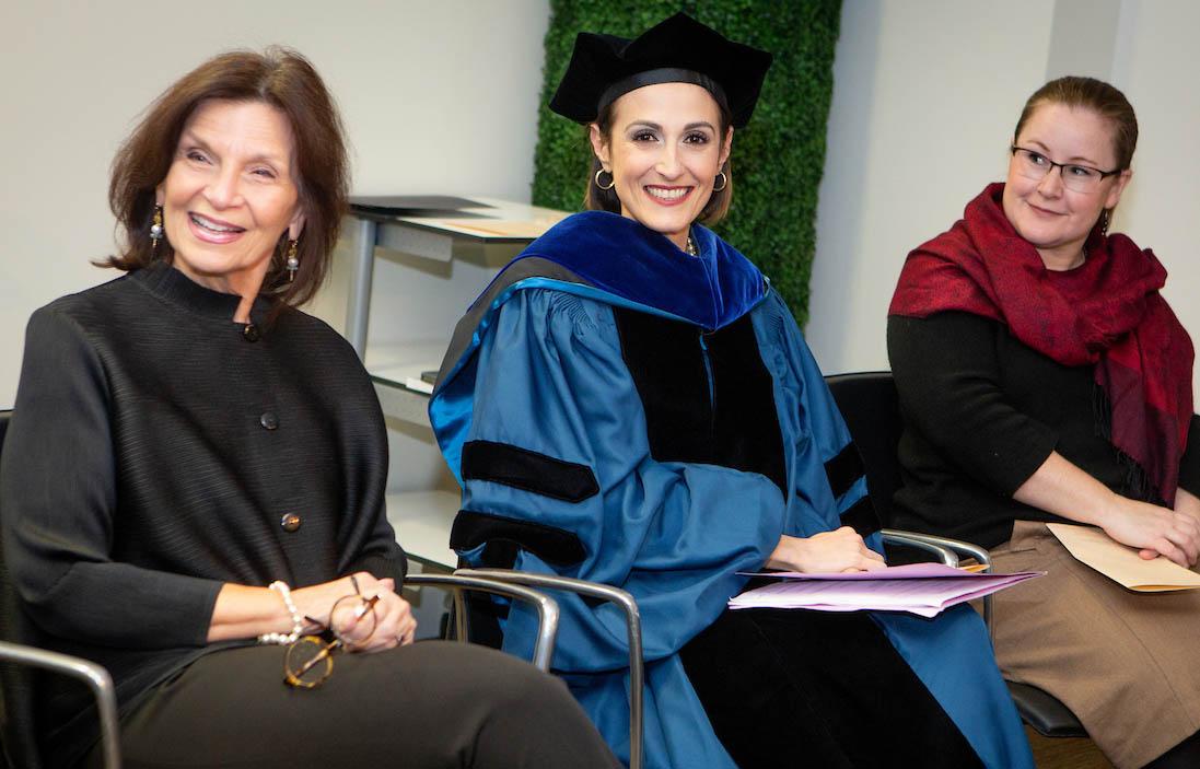 Dean Angela Evans with Professors Victoria deFrancesco Soto and Kate Weaver at the 2018 DC graduation