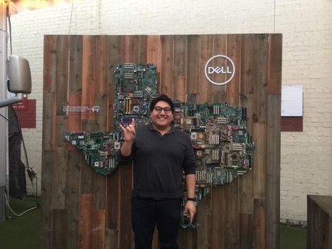 LBJ student Estevan Delgado poses in front of a Dell Texas installation