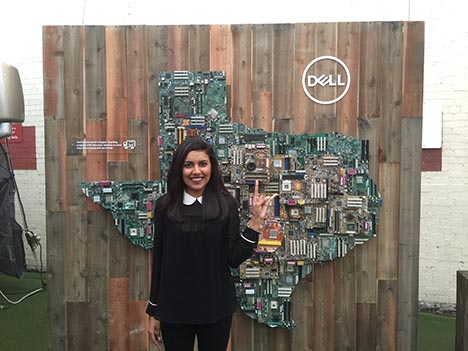 Sara Wadud stands in front of a Dell Texas installation