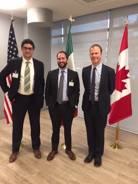 Fernando Rodriguez ('05), Drew Nelson '03 (LAS '03) and Jonathan Banks (LAS '94) standing in front of US, Mexican and Canadian flags