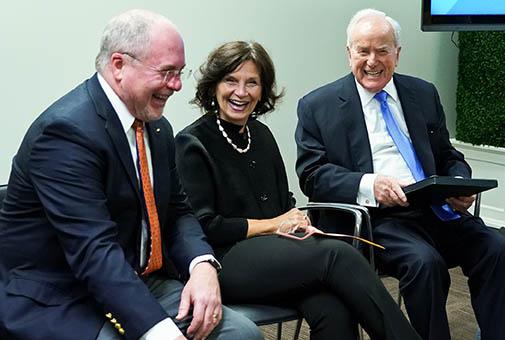 LBJ Washington Center Interim Director Bill Shute laughs with Dean Angela Evans and Lloyd Hand at the LBJ DC Fellows' graduation on Dec. 7