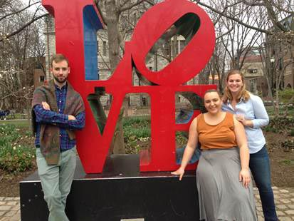 Students stand in front of the famous LOVE statue in Philadelphia