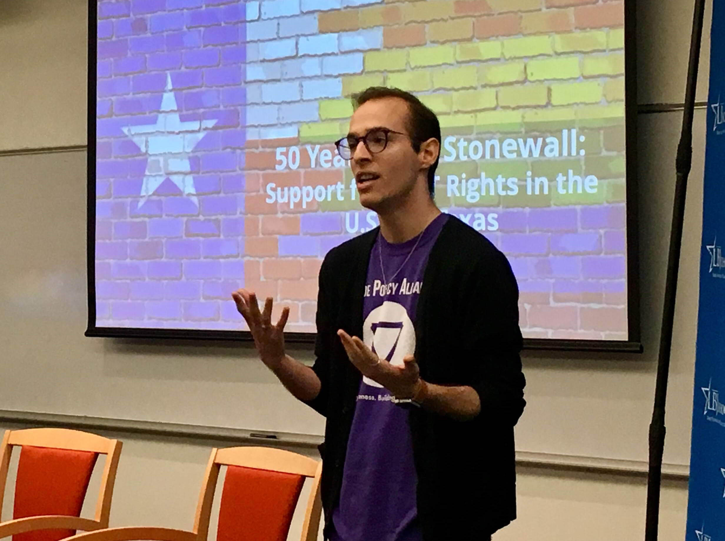 LBJ student Wayne Holstine (MPAff '19) speaks before the 50 Years After Stonewall event