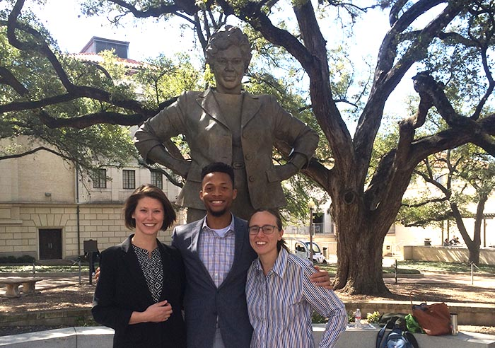 Three students serving as Barbara Jordan National Forum co-chairs stand in front of the Barbara Jordan statue