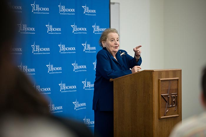 Secretary Madeleine Albright speaks at a podium at the LBJ School