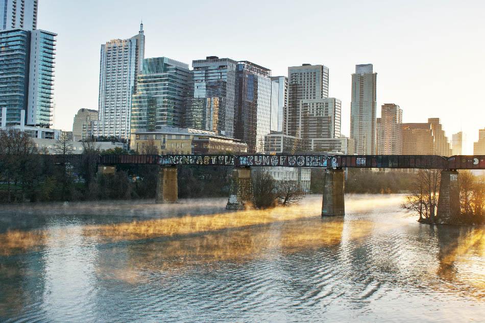 Downtown Austin skyline with pedestrian bridge