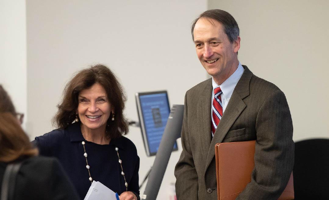 LBJ School Dean Angela Evans and Austin Smythe (MPAff '80)
