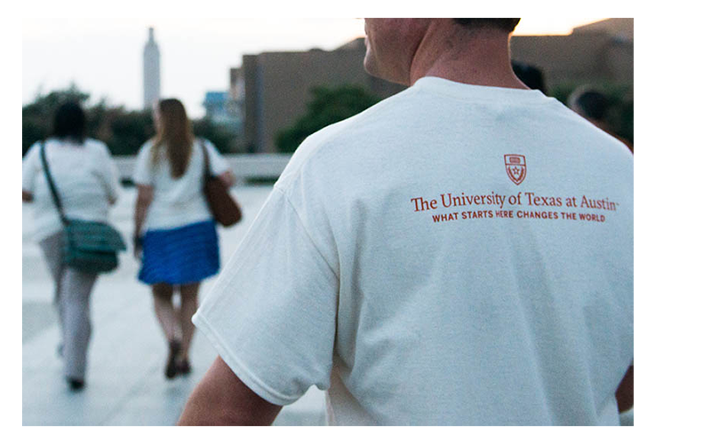 "Gone to Texas 2015: An LBJ student wears a UT T-shirt reading ""What starts here changes the world."""