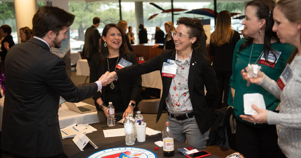An LBJ student and alumni introduce themselves during the 2019 LBJ School Career Fair