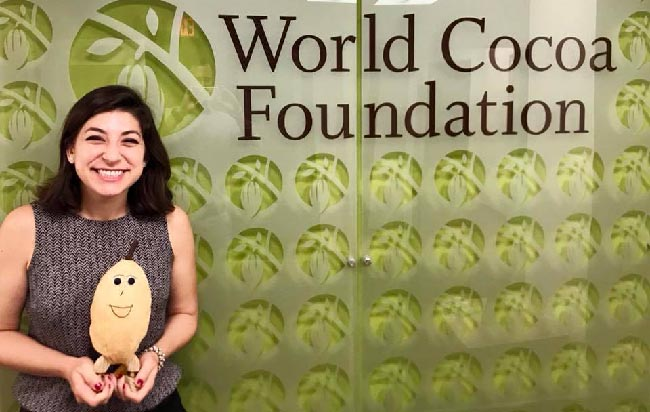LBJ student Melanie Levine holds a stuffed cocoa bean at the World Cocoa Foundation