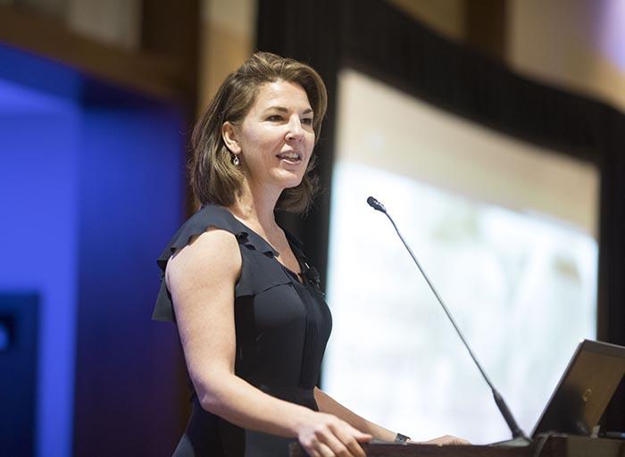 Cynthia Osborne speaks at the podium at the Fatherhood Summit