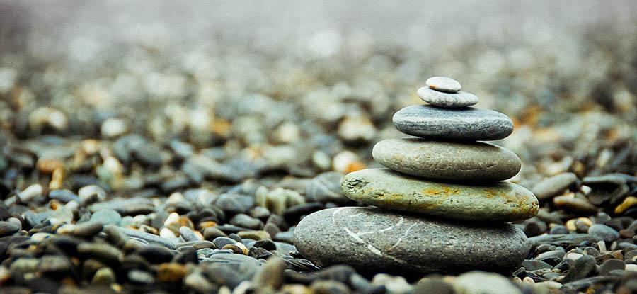 Rocks stacked and balanced. Credit: Johnson Wang, Unsplash
