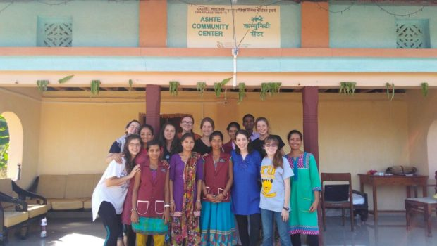 LBJ student Sarah Blumberg and her cohort shown in front of the Ashte village Community Center