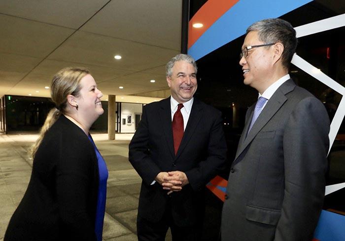 LBJ student Richelle Ramey meets Ambassador He Yafei (right) andCPPC Director David J. Firestein (center)