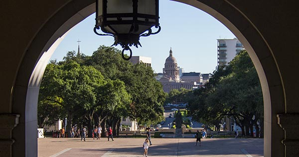 A view of the Capitol Building through the arch of the Main Building