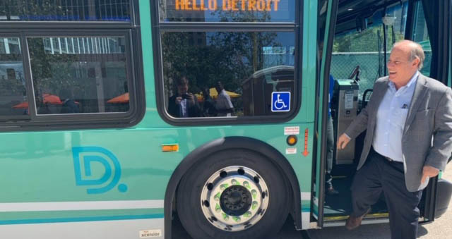 Detroit Mayor Mike Duggan disembarks from a city bus in his hometown
