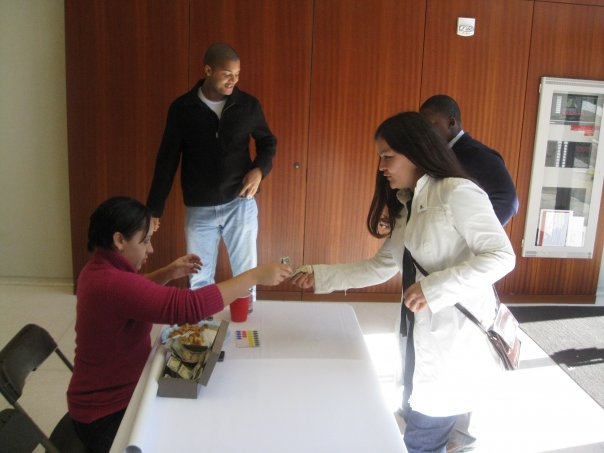 PAACC Treasurer Desiree Ledet takes donations at the door at the United Nations of Food