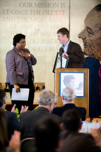 Stacey Abrams receives a proclamation from the Austin Mayor's Office