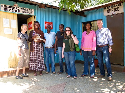 Emily Adams, 2011 LBJ School graduate (far left), and Todd Graham Smith (far right) pictured with workers from the women's center in Nairobi, Kenya.