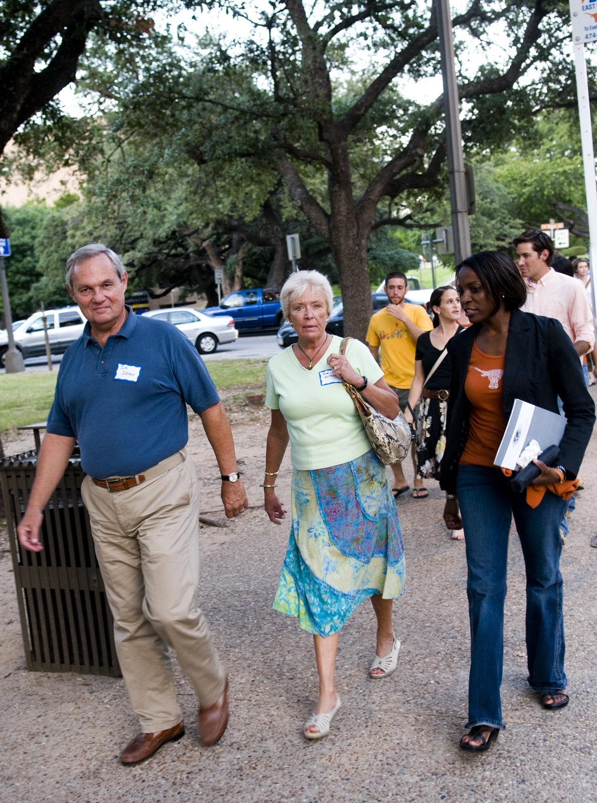 Mr. and Mrs. Hutchings lead the march to the UT Tower.