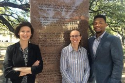 Barbara Jordan National Forum student co-chairs stand in front of a plaque with a quote from Barbara Jordan