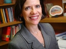 Faculty member Jacqueline Angel in her office