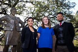 LBJ School students performing Barbara Jordan National Forum co-chair role with Barbara Jordan statue on Texas campus