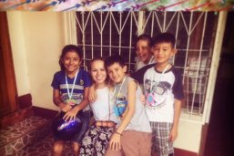 LBJ student Jessi Stafford with a group of kids in La Paz Centro, Nicaragua, pat of her internship with Artists for Soup
