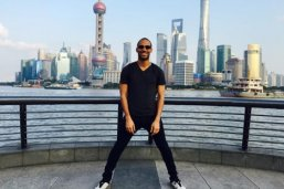 LBJ Student Kirt Smith stands in front of the Shanghai skyline