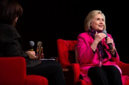 Hillary Clinton talks with LBJ School Dean Angela Evans during the In the Arena award ceremony