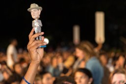An LBJ student holds an LBJ bobblehead aloft at the 2016 Gone to Texas