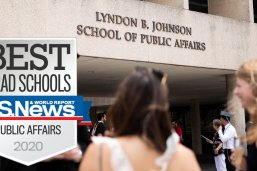Commencement 2019 celebration outside the LBJ School, with US News & World Report rankings banner