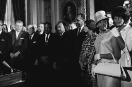 President Lyndon B. Johnson signs the Voting Rights Act on Aug. 6, 1965 as Martin Luther King Jr. and other civil rights leaders look on. (LBJ Library photo by Yoichi Okamoto)