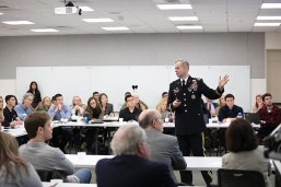 Lieutenant General Sean B. MacFarland in a classroom with LBJ students