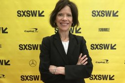 Jacqueline Angel in front of a South by Southwest backdrop