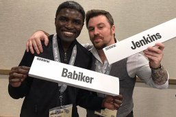 Joe Jenkins and fellow panelist hold up name tags, wear South by Southwest badges