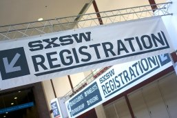 Banners and signs at the registration area for SXSW 2018