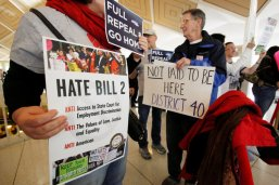 Opponents of North Carolina's HB2 law limiting bathroom access for transgender people protest in the gallery above the state's House of Representatives chamber as the legislature considers repealing the controversial law in Raleigh, North Carolina, U.S. on December 21, 2016. REUTERS/Jonathan Drake/File Photo