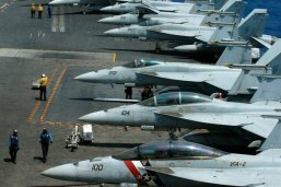 A row of F18 fighter jets on the deck of the U.S. Navy aircraft carrier USS Carl Vinson is prepared for patrols off the disputed South China Sea, March 3, 2017 (AP photo by Bullit Marquez).