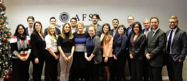 A group of students with representatives from the American Foreign Service Association