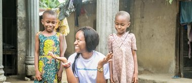 Amara in Nigeria with two children