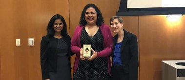 Students accept a University of Texas Tower Award